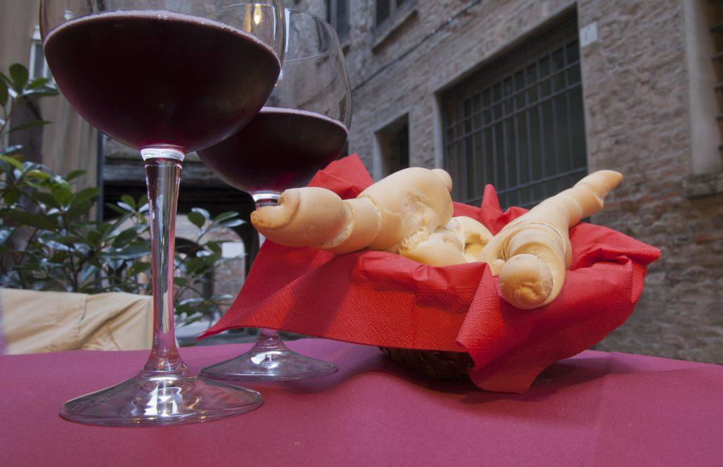 bread and red wine in Ferrara city, Italy