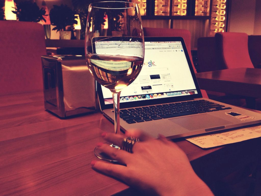 glass of wine by laptop