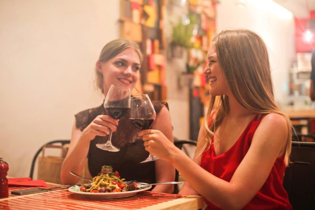 beautiful women drinking wine