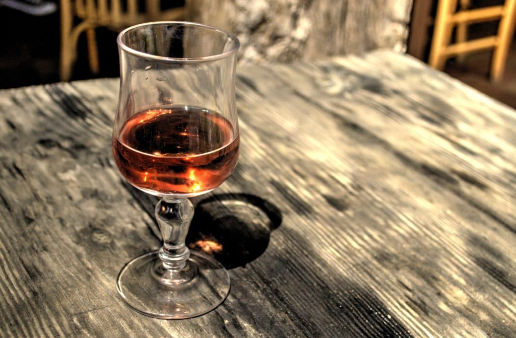 pretty pink wine outdoors on wooden table