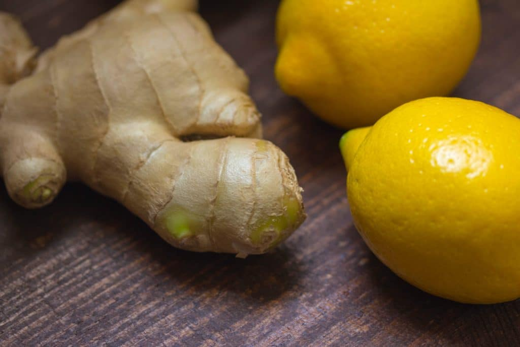close up of ginger root and lemons