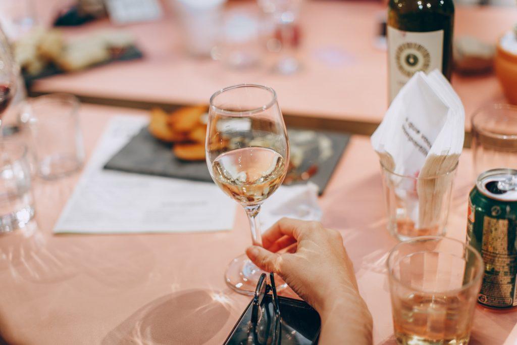 tasting a glass of white wine