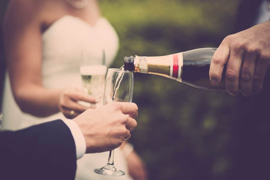 pouring champagne at a wedding
