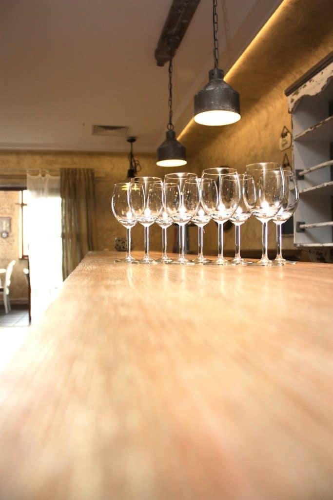 pretty wine glasses on a counter top