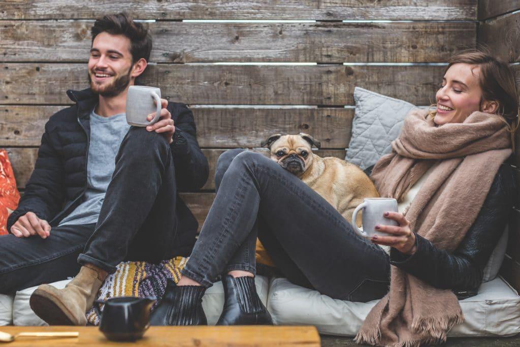 man and woman enjoying hot drinks