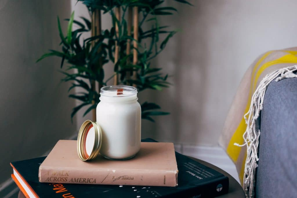 pretty mason jar filled with milk sitting on a book