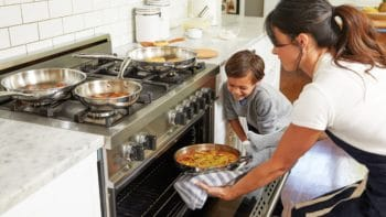 A family cooking in the kitchen.