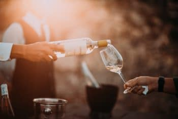 White wine being poured into a wine glass.