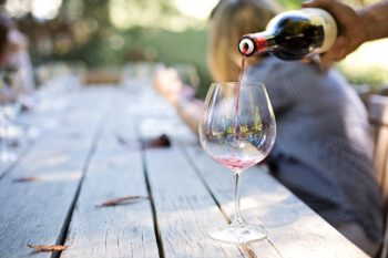 Wine being poured into a wine glass.