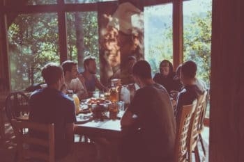 A group of people having dinner at a table.