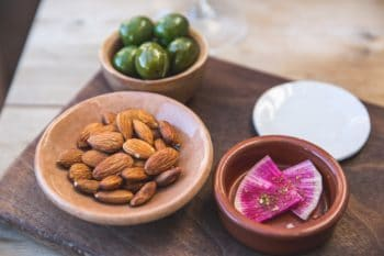 Bowls of almonds and olives.
