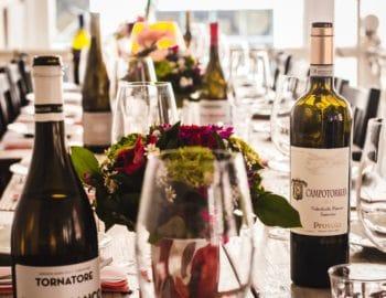 A table full of wine bottles.