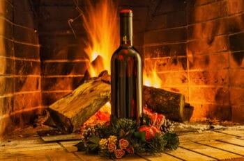 A bottle of wine on the background of the fireplac